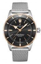 Мужские спортивные часы Breitling Superocean Heritage UB2030121B1A1 в биколорном корпусе, черный циферблат, стальной миланский браслет.