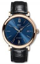 Мужские классические часы IWC Portofino IW356522 с датой в розовом золоте, на синем циферблате золотые часовые метки и тонкие стрелки, черный ремешок кроко.