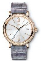 Женские наручные часы IWC Portofino IW458107 с датой в розовом золоте с бриллиантовым рантом, на посеребренном циферблате золотые метки и стрелки, ремешок кроко лилового цвета.