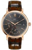 Мужские наручные часы IWC Portofino IW510104 с запасом хода и датой в розовом корпусе, на сером циферблате золотые метки и стрелки, ремешок кроко коричневого цвета.