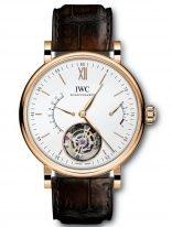 Мужские наручные часы IWC Portofino IW516501 с минутным турбийоном и запасом хода в розовом золоте, на посеребренном циферблате золотые метки и стрелки, коричневый ремешок кроко.