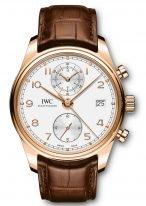 Мужские наручные часы IWC Portugieser IW390301 хронограф с датой в розовом золоте, на посеребренном циферблате углубленные счетчики хронографа, арабские цифры и стрелки, коричневый ремешок кроко.