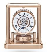 Настольные часы, которые не нуждаются в подзаводе, Jaeger Le Coultre Atmos-5117201 в корпусе с розовой позолотой, фазы Луны и месяц, часы и минуты, белый лаковый циферблат с черными римскими цифрами.