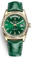 Мужские/женские часы Rolex Day-Date -118 138 в желтом золоте с зеленым циферблатом на кожаном ремешке.
